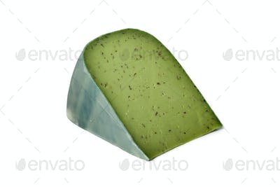 Piece of green pesto cheese