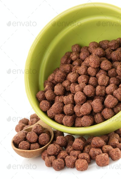 cereal chocolate balls in bowl on white
