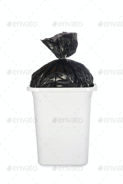 Bag of garbage in trash can