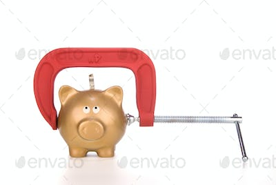 Piggy bank being squeezed