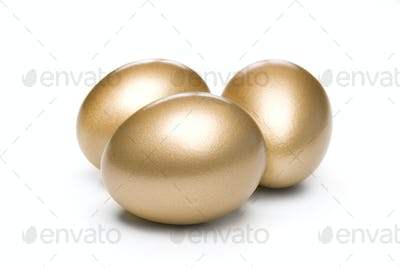 Golden eggs on a white background