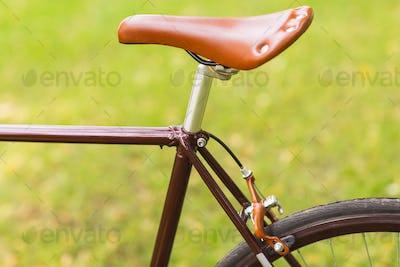 Stylish bicycle on grass