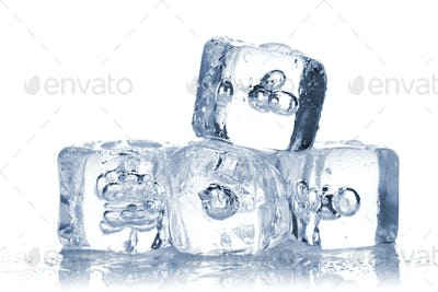 Melting ice cubes with water dew