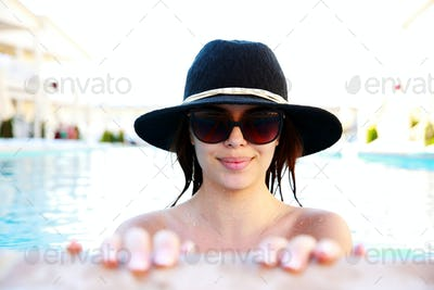 Portrait of a smiling cute girl in swimming pool