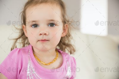 Close up portrait of a cute little girl at home