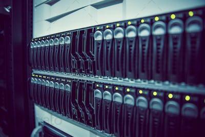 Black rack mounted server tower in large data center