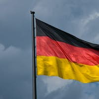 German flag in front of dark clouds