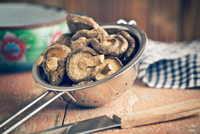 dried shiitake mushrooms in colander