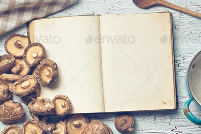 blank cookbook and shiitake