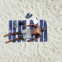 African male model sunbathing
