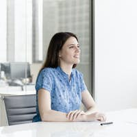 Businesswoman sitting and listening during a business meeting