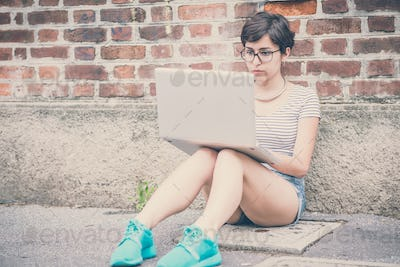 young hipster woman using notebook