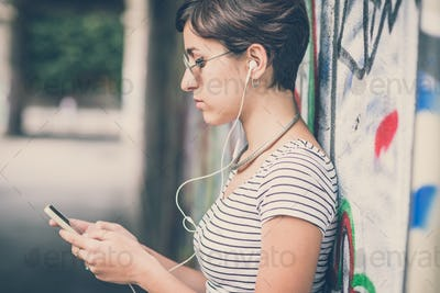 young hipster woman listening to music