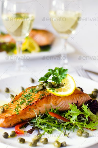 Grilled Salmon Fillet With Vegetables And A Glass Of White Wine