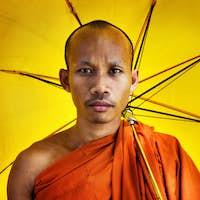 Buddhist Monk Holding Umbrella