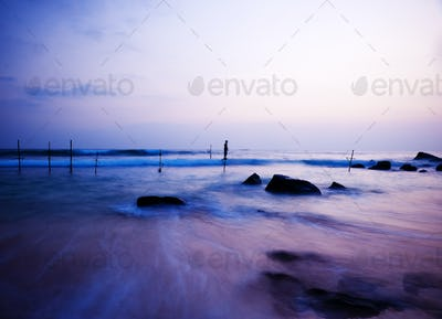 Dreamy Sea Coastline, Fishing Stilts with Young Boy Playing