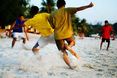 Playing Soccer on the Tropical Beach