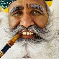India Man Smoking a Pipe
