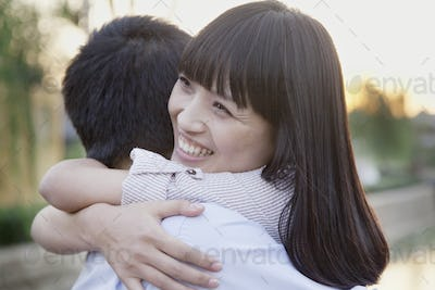 Happy Young Couple Hugging