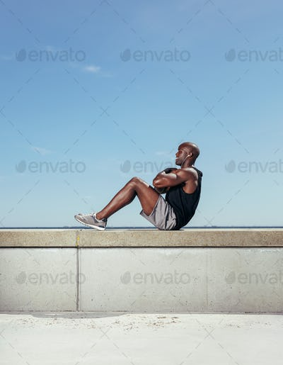 Fit young man exercising outdoors