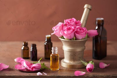 spa and aromatherapy set with rose flowers mortar essential oils