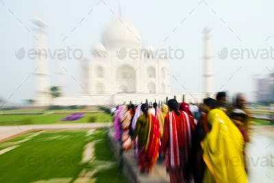 People Walking Through the Taj Mahal