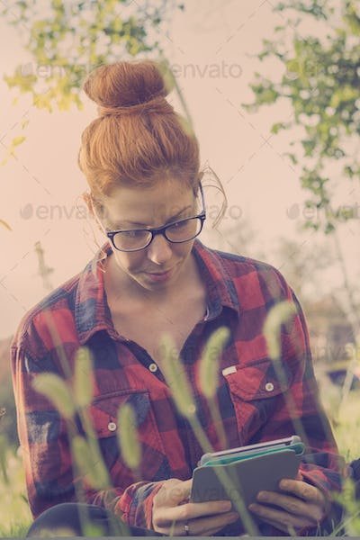 Cute hipster girl using tablet computer