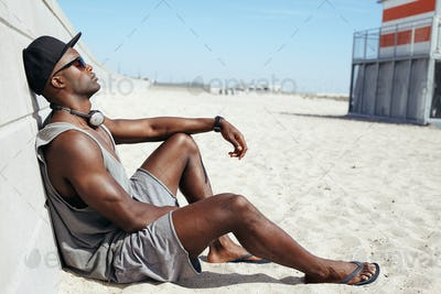 Man sitting on beach relaxing