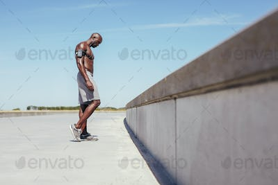 Shirtless young athlete relaxing after outdoor workout