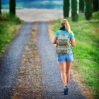 Young backpacker traveling along Europe