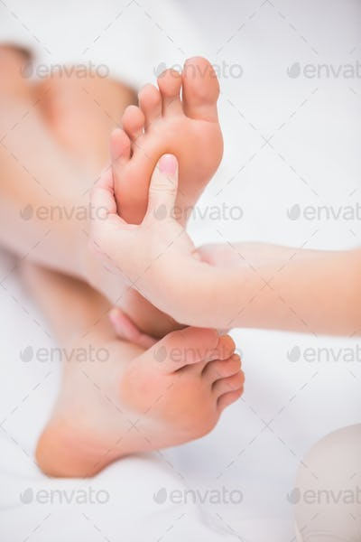 Woman receiving a foot massage at the beauty salon