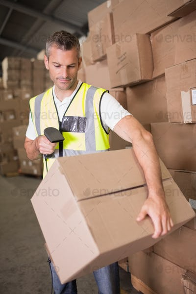 Manual worker scanning package in the warehouse