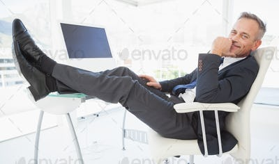A relaxing businessman enjoying his day at work