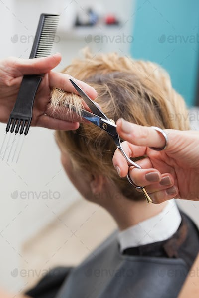 Hairdresser cutting a customers hair at the hairdressers