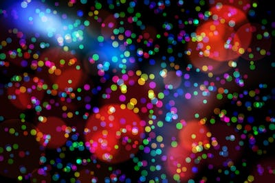 Colourful glowing dots on black with copy space