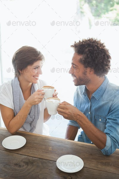 Casual couple having coffee together at the coffee shop