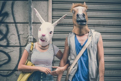 horse and rabbit mask couple of friends young  man and woman