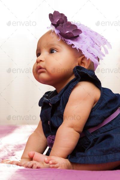 Adorable little african american baby girl looking - Black peopl