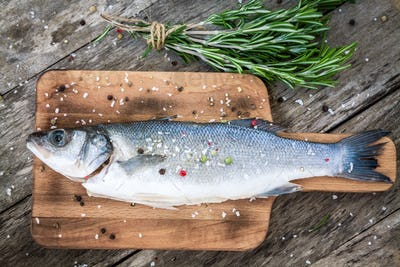 Two raw seabass with  rosemary