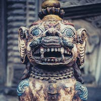 Stone lion at the entrance of a temple in Bhaktapur