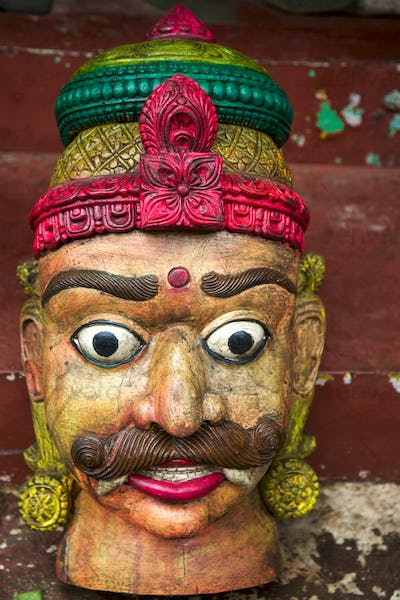 Old vintage head of statue in wood from Rajasthan in India