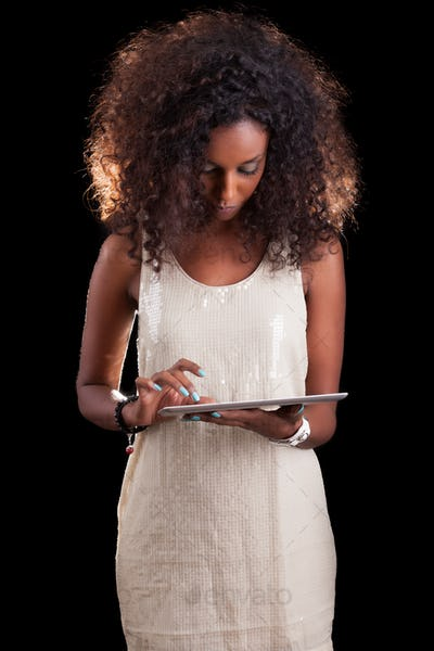 Young beautiful African American woman using a tactile tablet pc