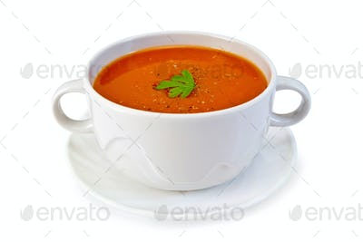 Soup tomato in white bowl with parsley