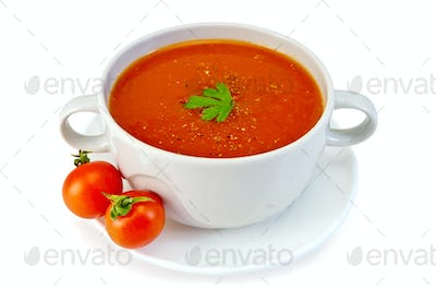 Soup tomato in white bowl with tomatoes