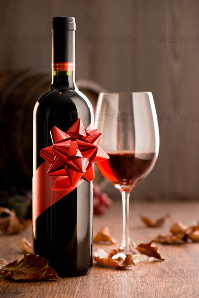 Excellent wine with ribbon and wineglass