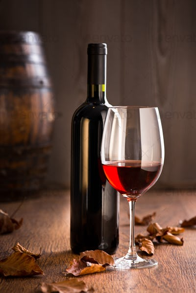 Wineglass with bottle