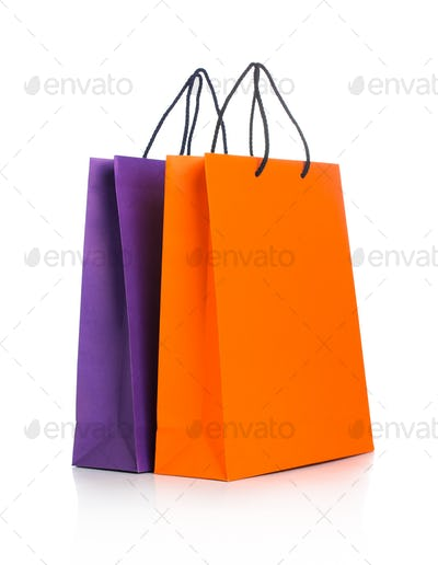 Two paper Shopping bags with reflection on white