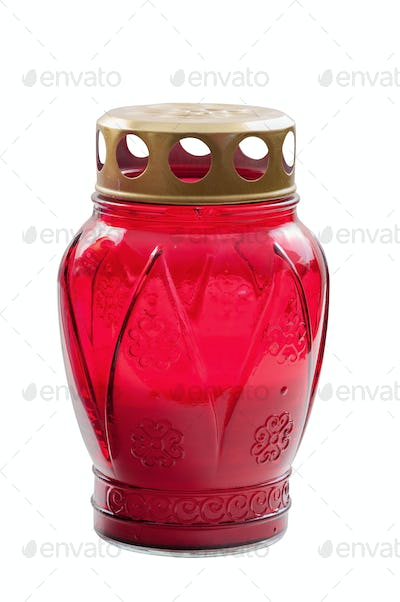 Red votive candle on white background