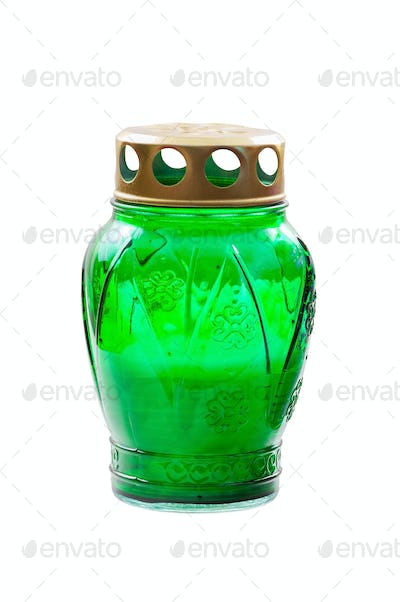 Green votive candle on white background