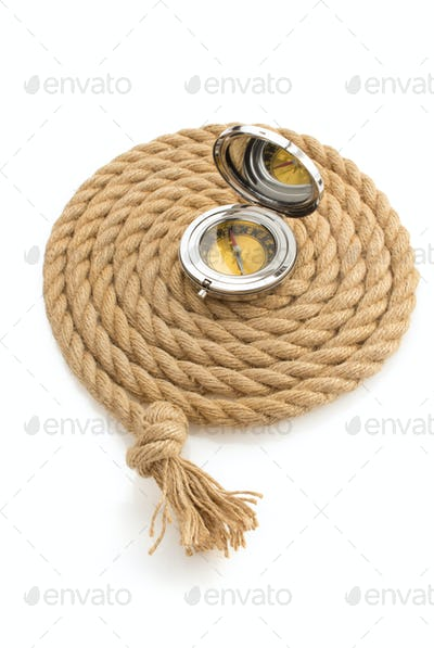 compass and ship rope on white